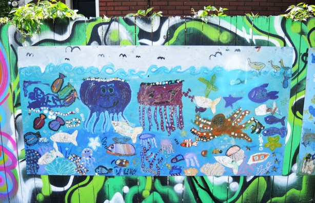 mural of a marine life scene with mostly jellyfish, octopus and fish