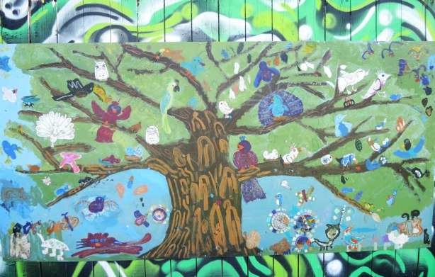 Mural done by a youth group of birds in the branches of a large tree
