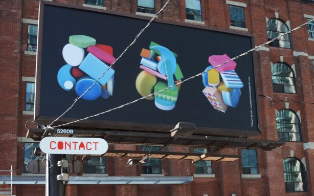 billboard art - three clusters of colourful sponges on a black background