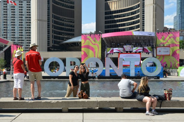 large three dimensional block capital letters that spell Toronto installed alongside the pool fountain in Nathan Phillips Square -
