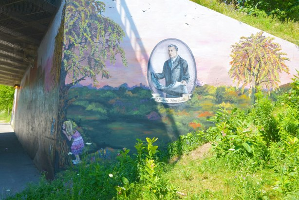 part of a mural on an underpass, including a portrait of a man, Robert Home Smith