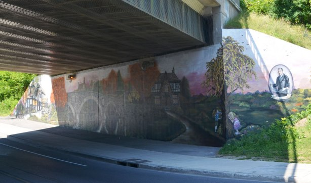 picture of a mural painted an the wall of an underpass.