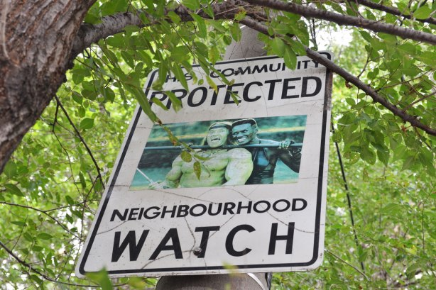 Neighbourhood watch sign with Grace Jones and Arnold Schwarzenegger from the movie 'Conan the Destroyer'