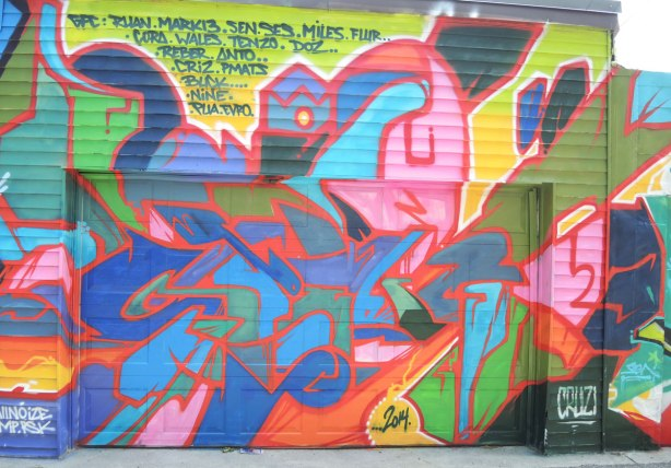 graffiti and street art in Graffiti Alley in Toronto - brightly coloured painting in many colours and shapes