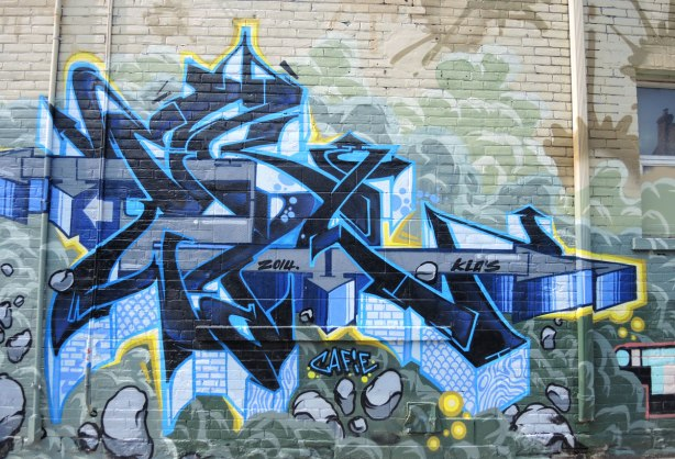 graffiti and street art in Graffiti Alley in Toronto - angular shaped tag in blues
