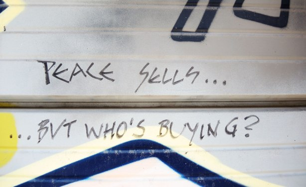 graffiti and street art in Graffiti Alley in Toronto - words scawled on a garage door,