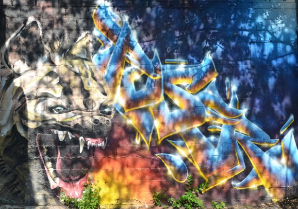 street art painting of a dog foaming at the mouth, mad dog