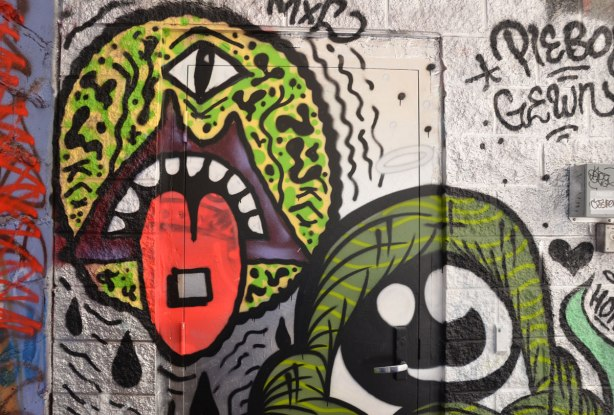 pieboy graffiti, large green one eyed monster