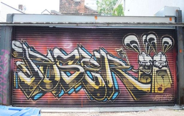poser bunny street art on a garage door