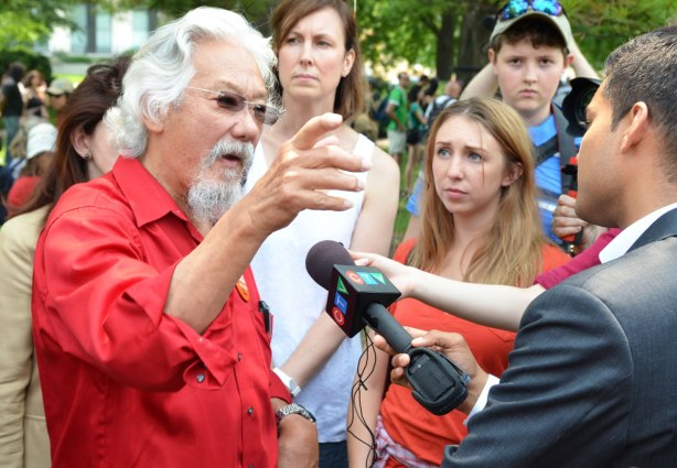 David Suzuki is being interviewed by a man from CTV.  A few people are standing behind.