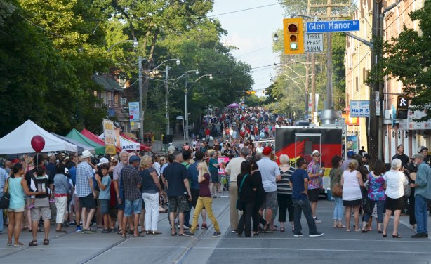 A crowd is on Queen St in Toronto as they have come to listen to live music as part of streetfest at the beach, intersection with Glen Manor Road