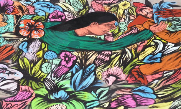 street artist painting of a woman with long black hair emerging from a bed of flowers.