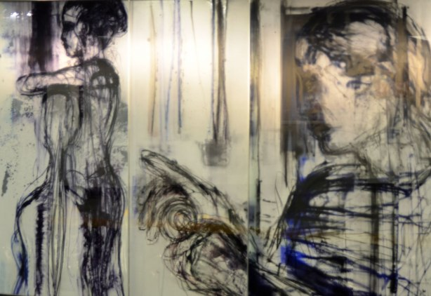 painting on glass panels, two women, on the left is standing, on the right is pointing to the left.