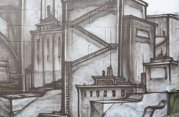 close up of a portion of the grey cityscape mural