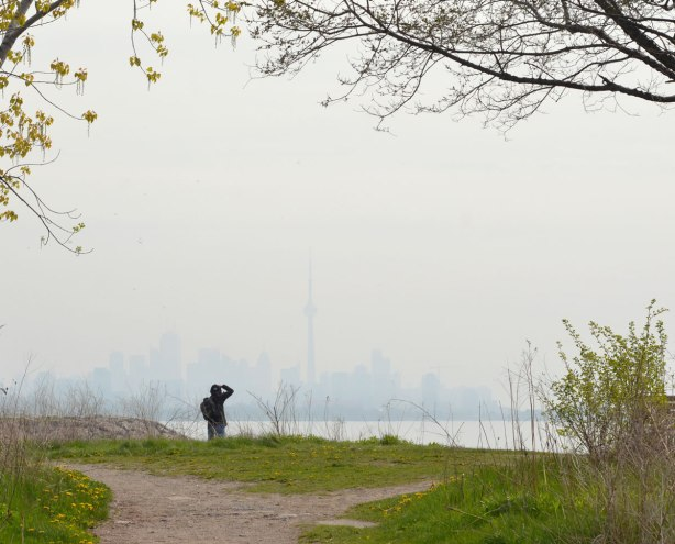 looking across a hazy Lake Ontario to the TOronto skyline