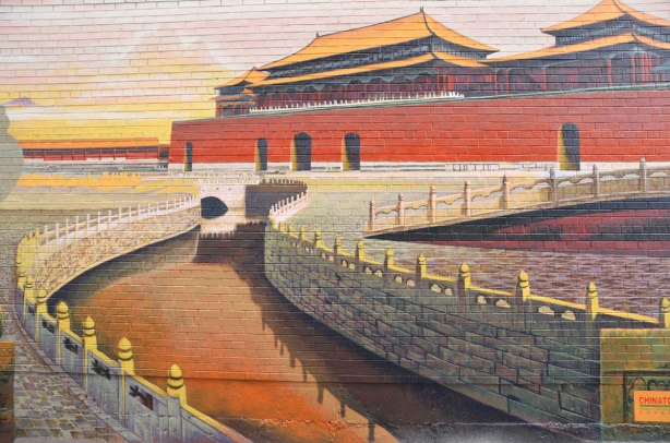 painting of one of the red buildings in the Forbidden City in Beijing China, part of a mural in an alley in Chinatown