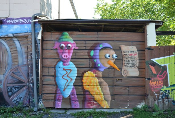 Two birdo creatures on a brown garage door