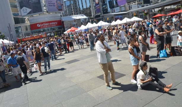 a large number of people at a festival at Yonge Dundas square.