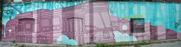 Greetings from Parkdale mural in light blue and purple featuring a ttc streetcar in shades of purple