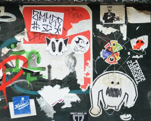 A number of stickers, or slaps, on a black metal box