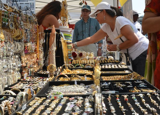 A woman is looking at jewellry that is for sale at an outdoor vendor at Panorama India, a festival in Toronto to celebrate India's 69th anniversary of independence day