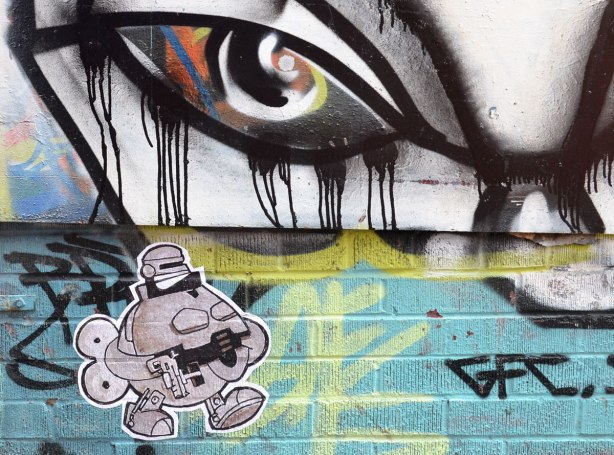 storm trooper, under an eye from another graffiti piece