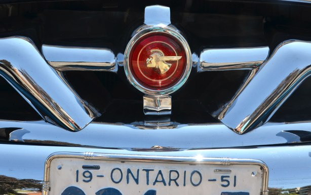 picture taken at a car show - detail of front of a 1951 Pontiac showing the badge with the Indian headin profile