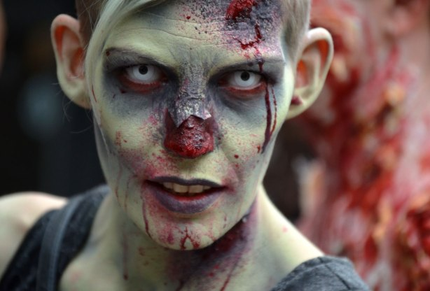 people dressed up as zombies - a zombie with a greenish face and missing a nose