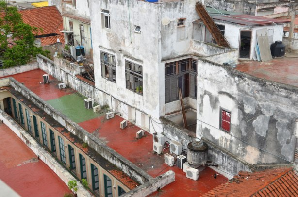 picture taken in the old part of the city of Havana Cuba - a view from a rooftop of other lower rooftops including one with a lot of air conditioners on it