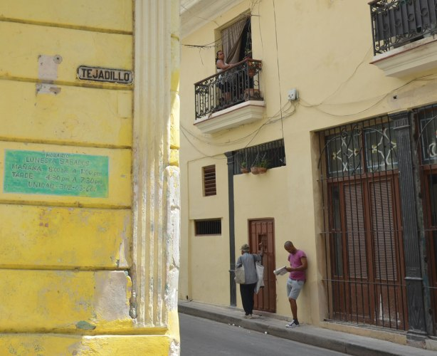 picture taken in the old part of the city of Havana Cuba - yellow buildings on calle trejadillo