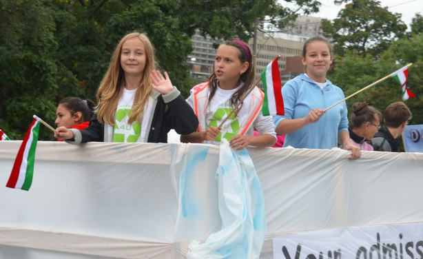 Three girls riding on a float in the Jesus in the CIty parade.