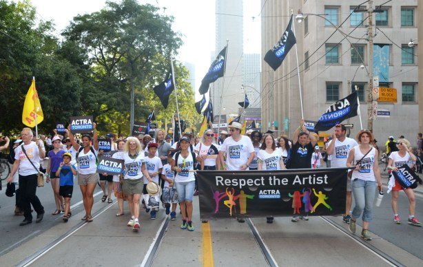 Labour day parade - ACTRA group walking behind a banner that says respect the artist