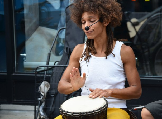female drummer from Amai Kuda and Yjosephine playing at Kensington Pedestrian Sunday