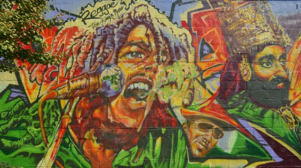 Part of a very colourful mural depicting various reggae musicians -