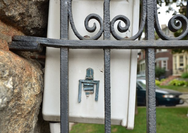 Stickman behind a wrought iron fence. He is missing the lower half of his body
