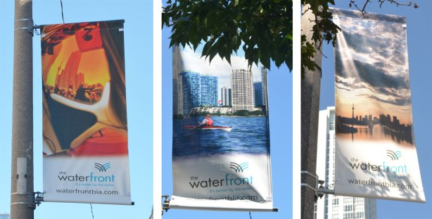 A composite of three pictures, each of a vertical banner hanging from a pole outdoors along a street. One banner is a kayaker in the harbour in front of the Toronto skyline. Another is a sunset over Toronto skyline on a cloudy day