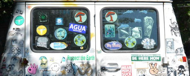 back windows of a chevy van covered with stickers