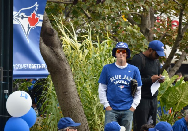 Before a Blue Jays baseball game at the ROgers Centre - a man watches over the crowd
