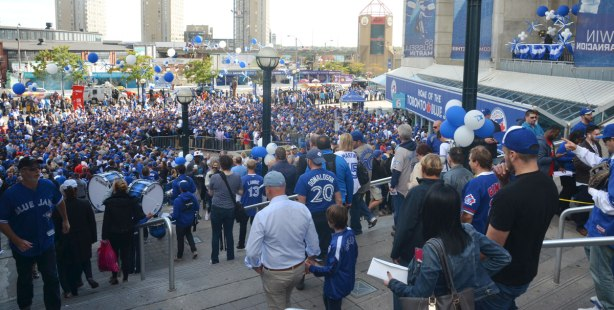 Before a Blue Jays baseball game at the ROgers Centre - many people on the stairs to the east of the stadium, and many people waiting in the square below, trying to get into the stadium through gate 6.