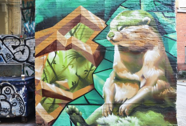 Street art painting of a large rodent like creature sitting Brown, furry, little paws, small feature on face,