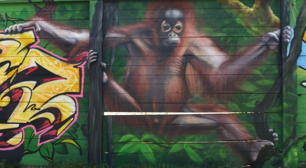 street art painting of a brown monkey
