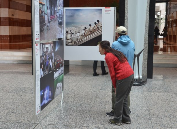 people looking at photographs, the winning pictures from the World Press Photo contest, on display at Brookfield Place