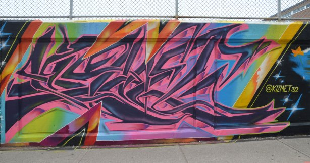 street art on an underpass wall by kizmet32, pink and purple on blue