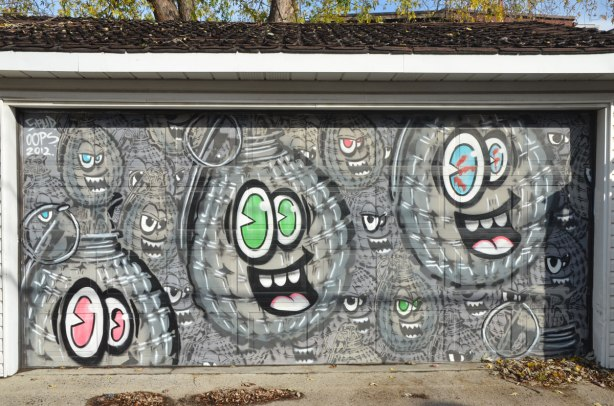 Garage door covered with spud bombs street art