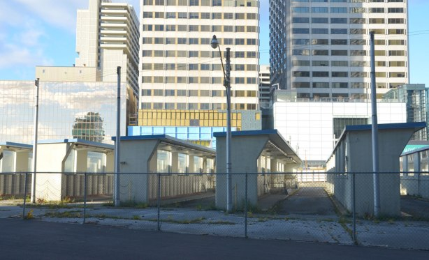 abandoned bus bays at Eglinton subway station in the foreground and the newer taller buildings in the area in the background