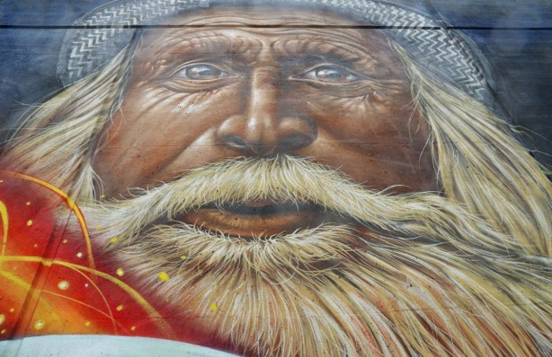 part of a larger mural on an underpass in Toronto, on Lawrence West, a close up of an old bearded man's face.
