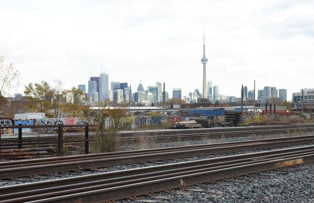 A view of the CN TOwer and the Toronto skyline from north west of downtown. Railway tracks are in the foreground.