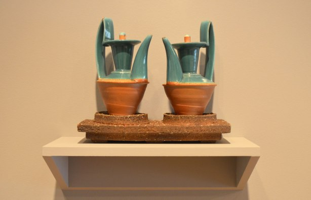 Two artistic ceramic pieces by Bruce Cochrane on a small shalef
