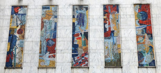 five vertical panels of mosaic in bright colours on an exterior wall