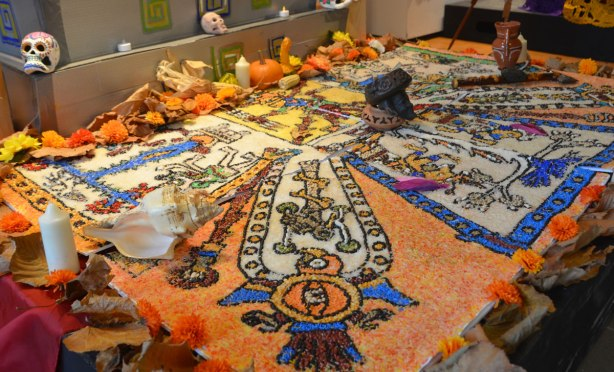 pictures made of coloured rice on an ofrenda dedicated to the indigenous people of Mexico